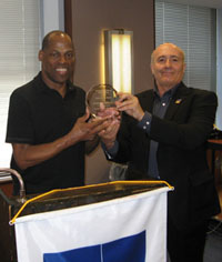 Adrian Bailey accepts his award from Jean-Paul Richard