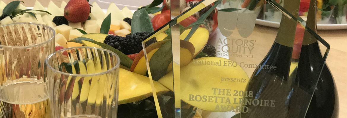 The LeNoire Award plaque sits on a table surrounded by fruit, cheese and champagne