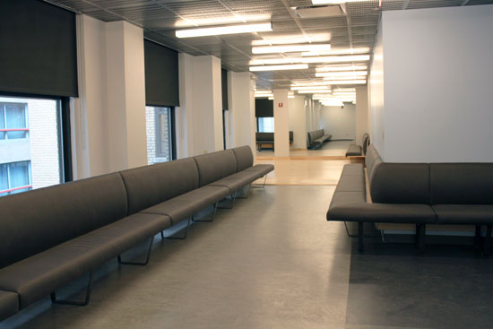 The audition waiting area has ample couches along all available wall space.